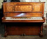 An antique, Bechstein upright piano with a rosewood case and floral inlaid panels. 
