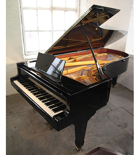 A 1971, Bluthner concert grand piano with a black case