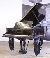 Steinway Model A Grand Piano For Sale with an ebonised case. Piano has three barrel legs each carved with figures playing musical instruments and floral relief detail.
