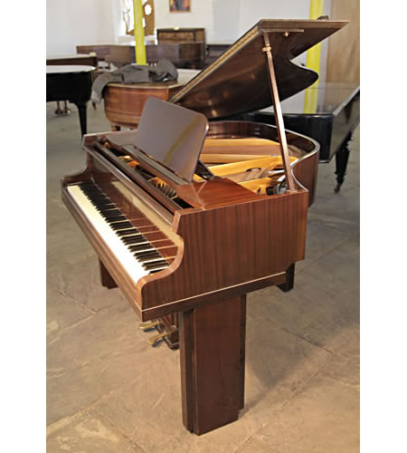 A 1939, Art Deco Allison baby grand piano with a polished mahogany case