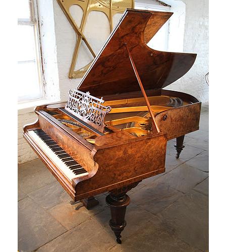 An antique, 1888 Bechstein Model C grand piano with an exquisite, burr walnut case