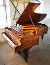 An 1888, Bechstein Model C grand piano with an exquisite, burr walnut case.