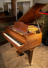 An 1936, Bechstein Model K baby grand piano with a mahogany case.