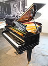 A 1902, Bechstein Model L grand piano with a black case.