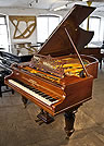 An antique Bechstein Model V grand piano with a rosewood case.