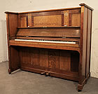 Piano for sale. An Arts and Crafts Bechstein  upright piano with an inlaid oak case