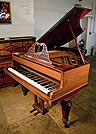 Piano for sale. An antique,  Broadwood grand piano with a polished, rosewood case and filigree music desk