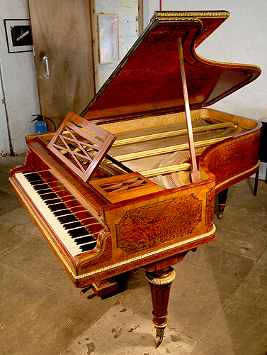 Erard grand piano for sale with a rosewood and sapele mahogany case with brass ormolu inlay.