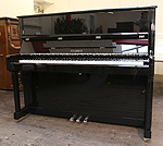 Piano for sale. A Feurich Model 122 upright piano with a black case.