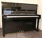 Piano for sale. A Feurich Model 122 upright piano with a black case and chrome fittings.