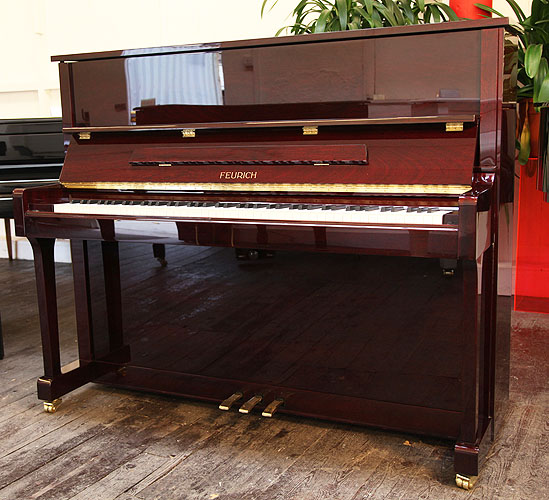 Brand New, Feurich Model 122 upright Piano for sale with a mahogany case.