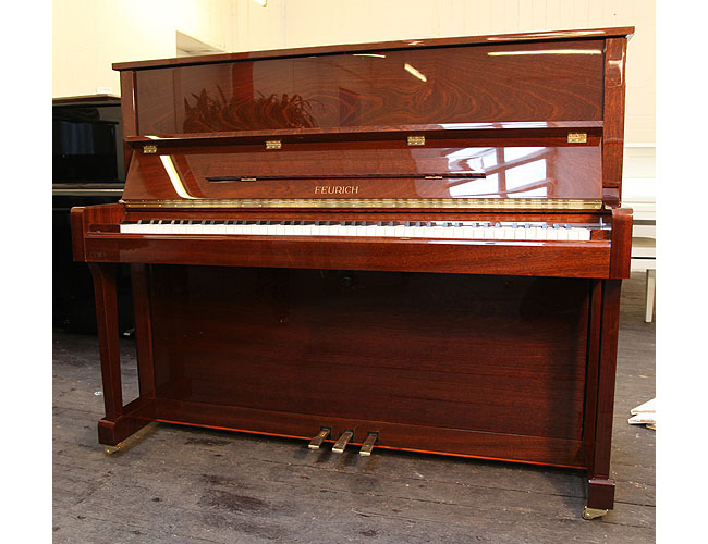A Brand New Feurich Model 122 upright piano with a Walnut Gloss case and brass fittings