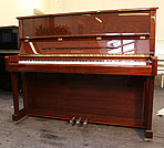 Piano for sale. A Feurich Model 122 upright piano with a walnut case.