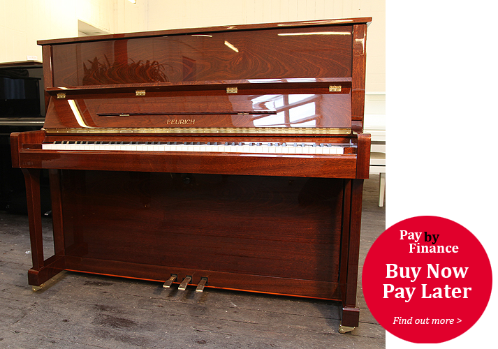 Brand New, Feurich Model 122 upright Piano for sale with a walnut case.