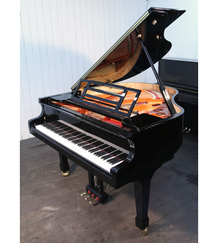A brand new, Feurich Model 161 Professional grand piano with a black case and brass fittings