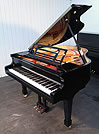 Piano for sale. A Feurich model 161 grand piano with a black case and polyester finish.