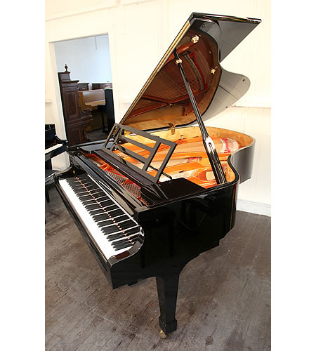 A brand new, Feurich Model 178 Professional grand piano with a black case and brass fittings