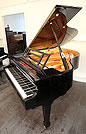 Piano for sale. A Feurich model 178 grand piano with a black case and polyester finish.