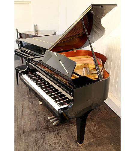 A brand new, Kawai GE20 baby grand piano with a black case and polyester finish