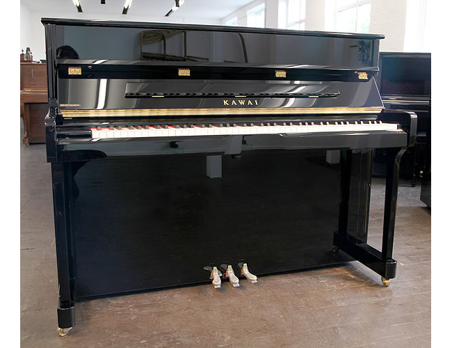 A Kawai K2 upright piano with a black case and polyester finish