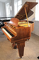 Monington and Weston grand piano.