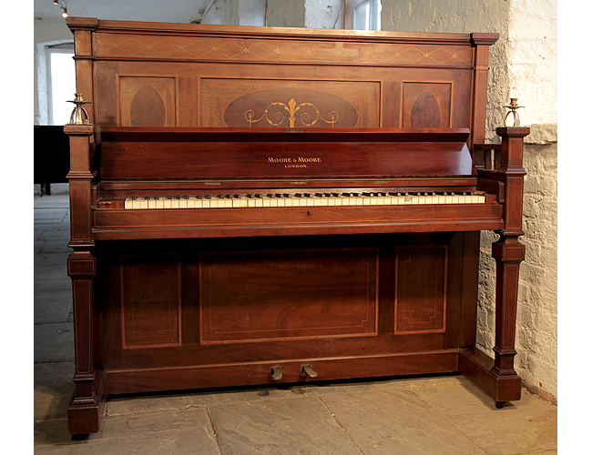 A Moore and Moore upright piano with a mahogany case, inlaid with crossbanding, stringing, floral motifs and scrolls