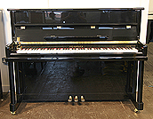 Piano for sale. A brand new Steinhoven Model 112 upright piano with a black case.
