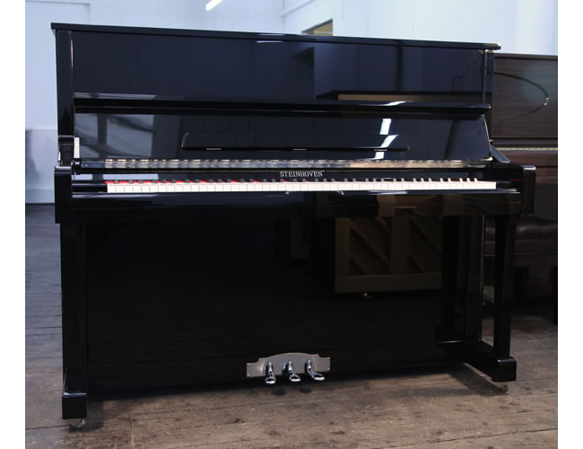 A brand new Steinhoven model 121 upright piano with a black case and polyester finish. Piano features a soft fall and foot plate.