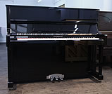 Piano for sale. A brand new Steinhoven model 121 upright piano with a black case.