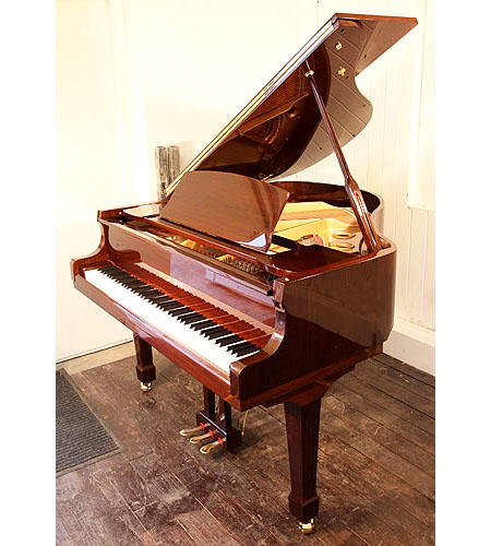A brand new, Steinhoven Model 148 baby grand piano with a mahogany case and polyester finish