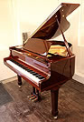 Piano for sale. A brand new Steinhoven Model 148 baby grand piano with a mahogany case and polyester finish. Great value for money.