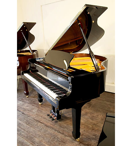 A brand new, Steinhoven Model 160 baby grand piano with a black case and polyester finish