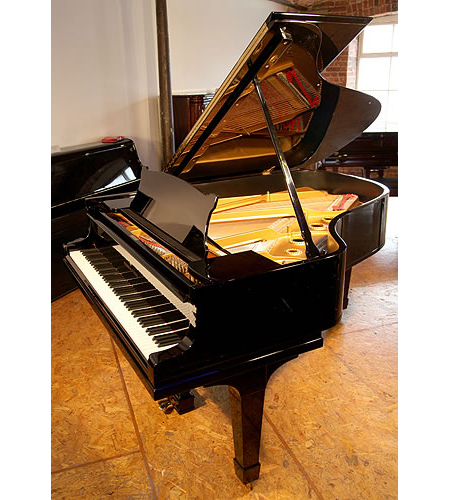 A 1925, Steinway Model A grand piano with a black case and spade legs