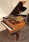 An antique, Steinway Model A grand piano with a polished, rosewood case inlaid with satinwood stringing. 