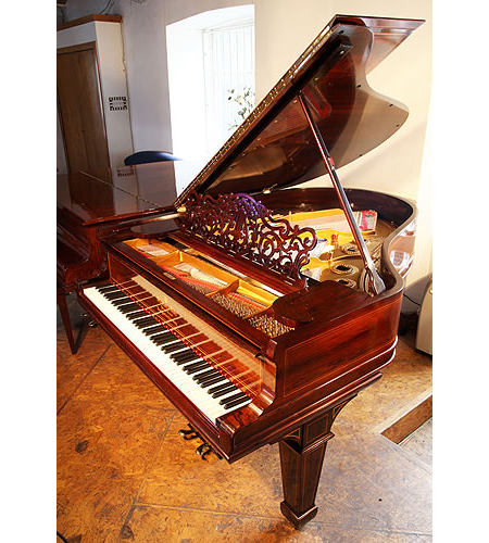A 1900,  Steinway Model A grand piano with an inlaid, rosewood case
