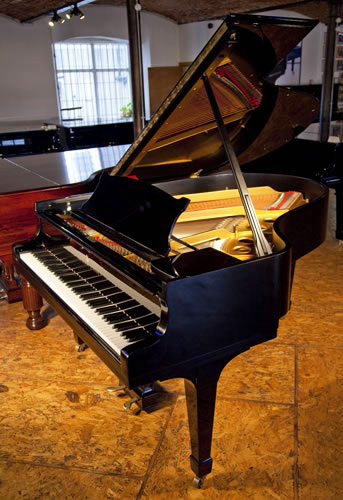A 1952, Steinway model O grand Piano for sale.