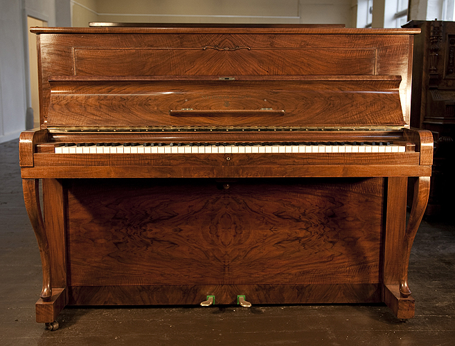 Steinway Model Z upright Piano for sale with a walnut case.