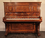 An antique Steinway upright piano with a burr walnut case.