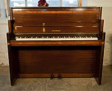 Piano for sale. An art-deco Waldberg upright piano with a mahogany case