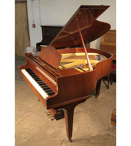 A 1970, Welmar baby grand piano with a polished, mahogany case