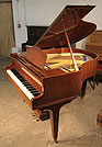 Piano for sale. A Welmar Baby Grand with a  mahogany Case.