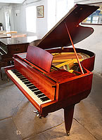 A 1955, Yamaha No20 grand piano with a satin, mahogany case. Piano features unusual, angular case styling. Piano lyre rests on a single rod. A rare chance to own a collectable, vintage Yamaha.