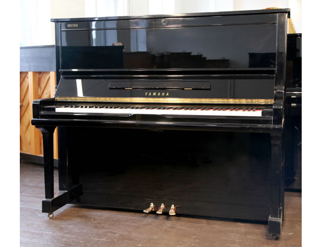A 1994, Yamaha U30AS upright piano with a black case and polyester finish
