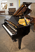 Young Chang G157 Baby Grand Piano For Sale with a black case