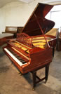 An 1912, Bechstein model B grand piano with a mahogany case and gate legs