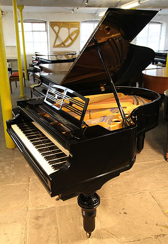 Feurich  grand Piano for sale with a black case.