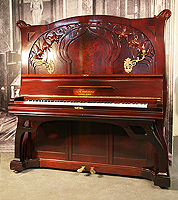 A 1914, Art Nouveau, Knauss upright piano with a mahogany case with carved flowers and tendrils