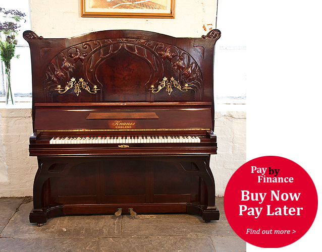 Knauss upright Piano for sale.