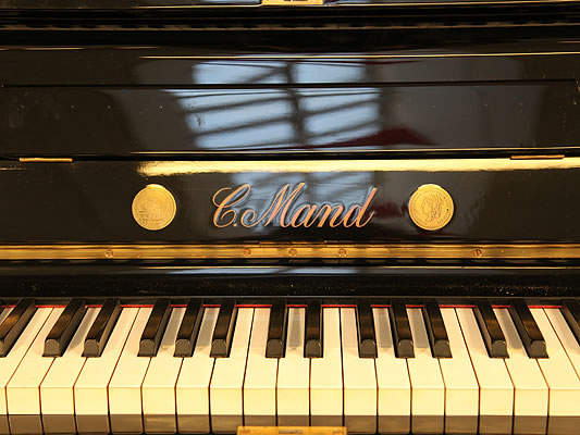 C. Mand Upright Piano for sale.