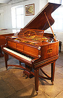 Artcase, Schiedmayer grand piano for sale with a satinwood case. Cabinet features crossbanding and boxwood stringing accents and is hand painted in romanesque designs with cherubs, soldiers and dancing ladies. Piano has gate legs and an elegant serpentine cross stretcher.